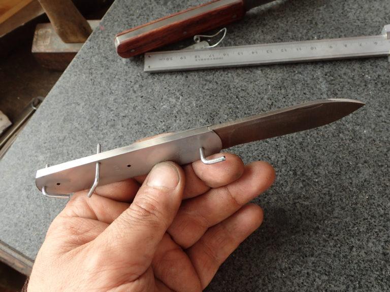 mécanisme de couteau pliant
